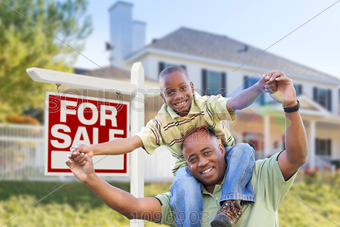 Stock Photo of Piggyback african american boy on black dad outside house  with for sale signage horizontal - African American Dad PNG
