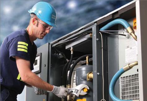 Atlas Copco technician performing regular maintenance on an Atlas Copco air  compressor. - Atlas Copco Service PNG
