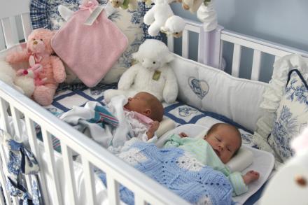 twins sleep together in same crib - Baby Sleeping In Crib PNG