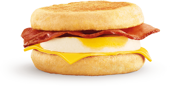 A perfectly cooked free range egg, deli style bacon and a slice of cheese,  cased in a toasted, warm English muffin. - Bacon And Egg PNG