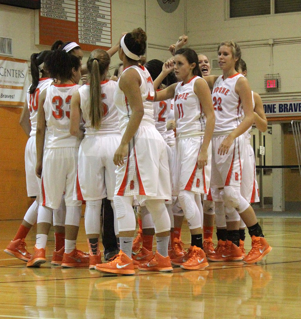 GO TEAM. The Lady Braves huddle together to prepare for the game against  Apopka. photo/Conor Kvatek - Basketball Team Huddle PNG