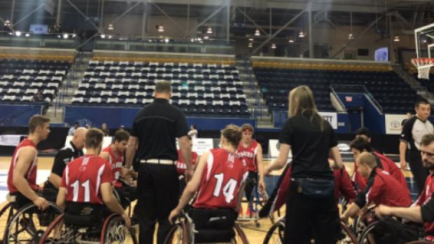 Members of Canadau0027s menu0027s wheelchair basketball team huddle prior to their  match against Turkey at the - Basketball Team Huddle PNG