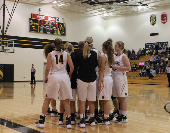 The Atlantic girls basketball team breaks down from their huddle before the  game against Winterset. - Basketball Team Huddle PNG