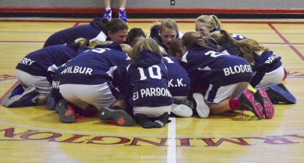 The Mt. Blue girls travel team in their huddle before the game. - Basketball Team Huddle PNG
