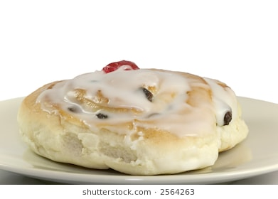 Sticky Belgian bun with a glazed red cherry on a plate isolated against a  white background - Belgian Bun PNG