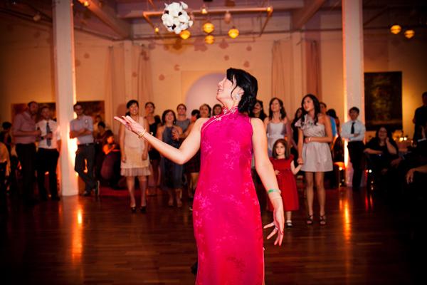 Bride with a wedding dress change doing the bouquet toss at a San Francisco  wedding reception - Bouquet Toss PNG