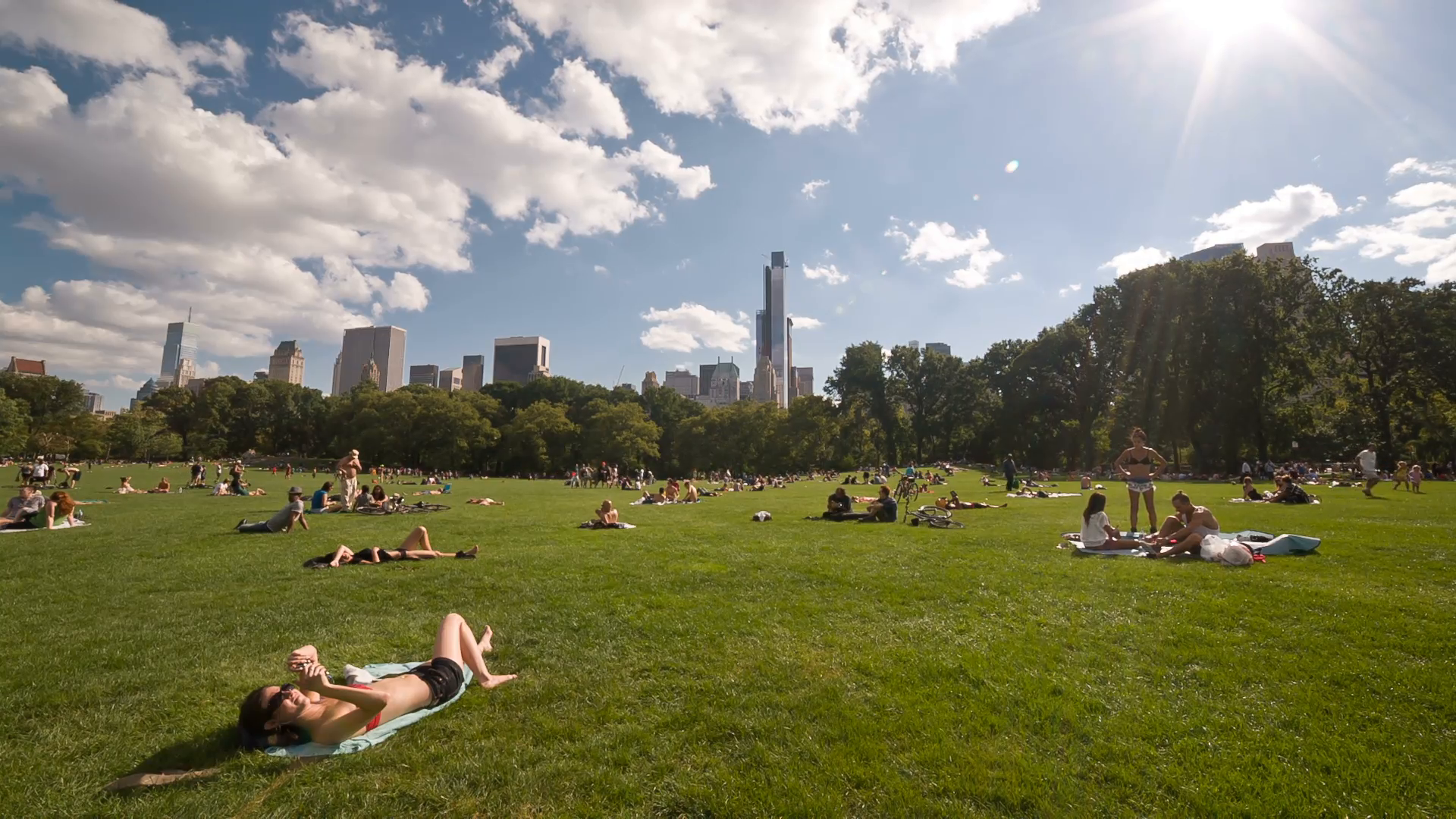 bright sun on hot sunny day in Central Park, people tanning on towels in  Manhattan NYC Stock Video Footage - VideoBlocks - Bright Sunny Day PNG