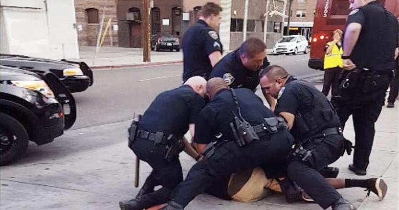 a f*cking kidu0026 Video shows nine California cops arrest sobbing black teen u0026  jaywalkingu0026 - Cop Arresting Someone PNG