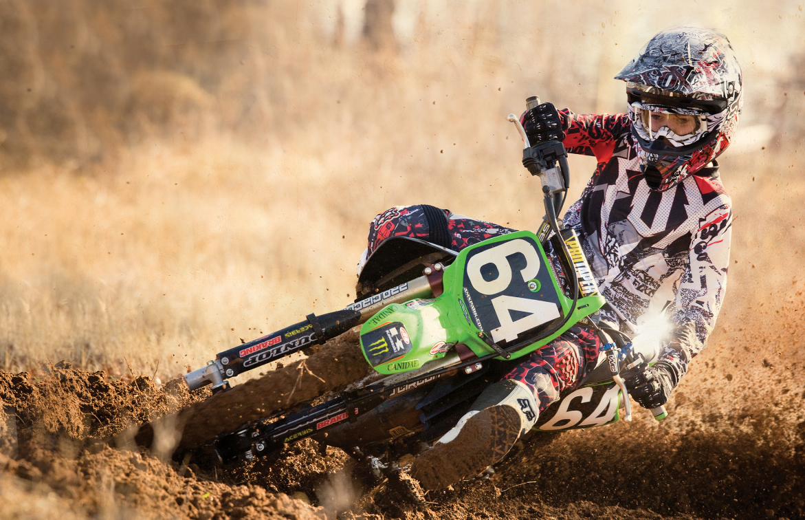 A Youth Motocross Racer Outfitted in Fox Gear on a Kawasaki Dirt Bike - Dirt Bike PNG HD