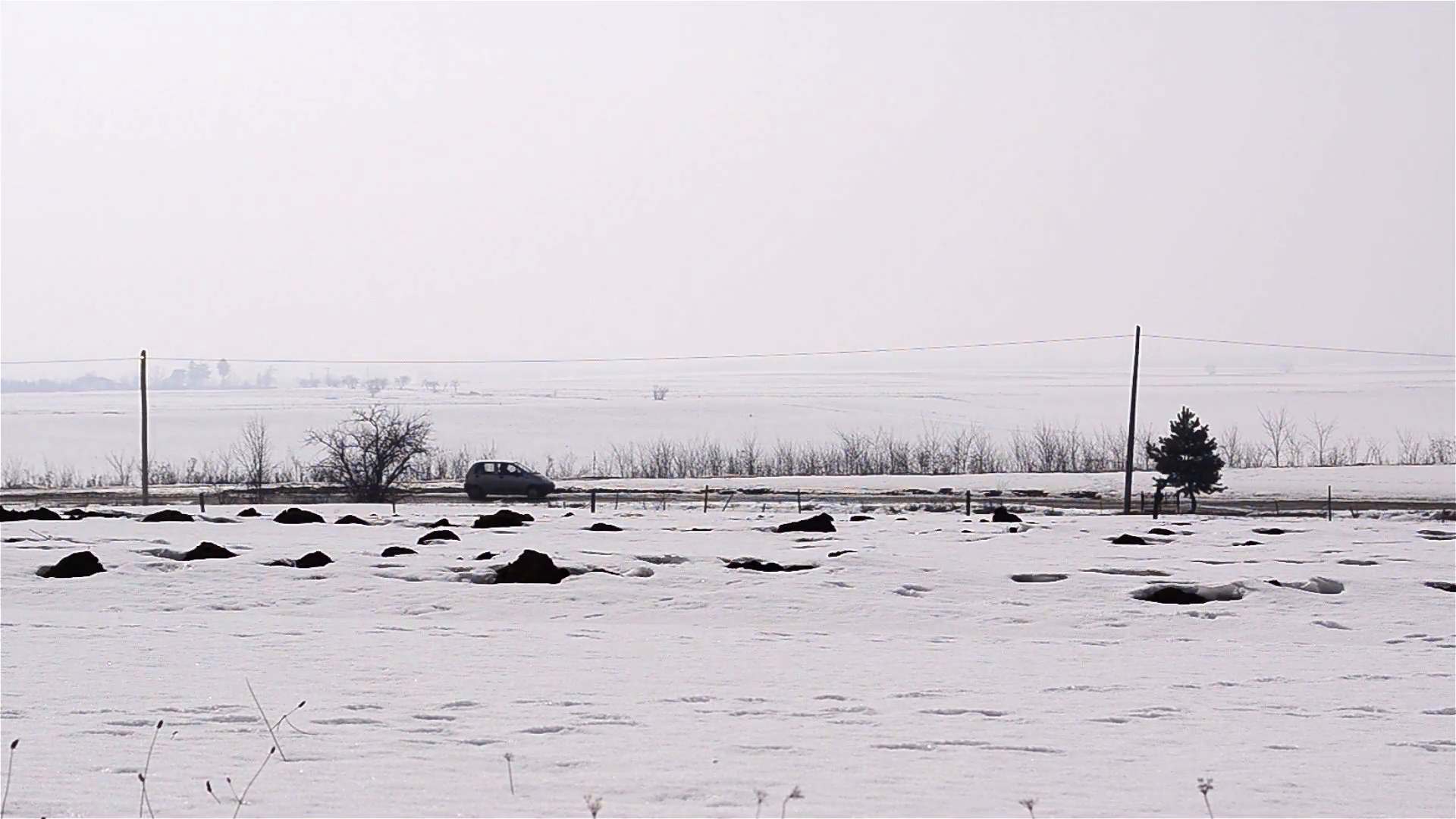 Car goes on a road bordered by farm fields covered with snow 1 Stock Video  Footage - VideoBlocks - Farm Fields PNG Black And White