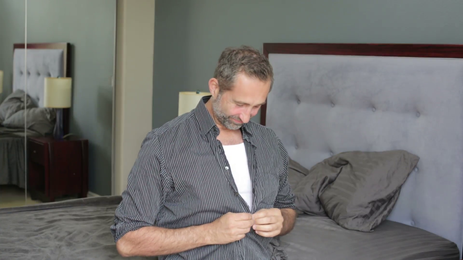 businessman sitting on bed and getting dressed in the morning Stock Video  Footage - VideoBlocks - Getting Dressed PNG HD