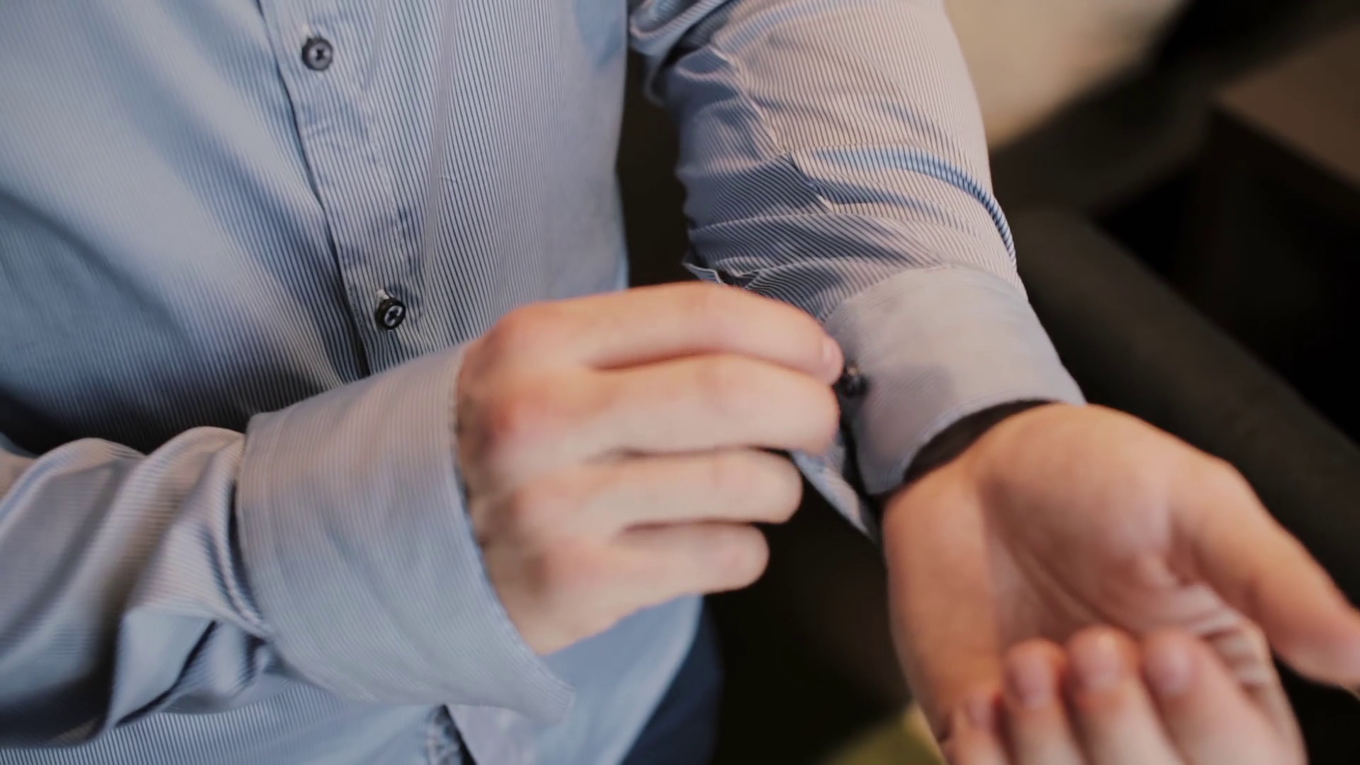 Close-up view of young male hands getting dressed at morning. Man buttons  cuffs on a shirt, preparing for work. Stock Video Footage - VideoBlocks - Getting Dressed PNG HD