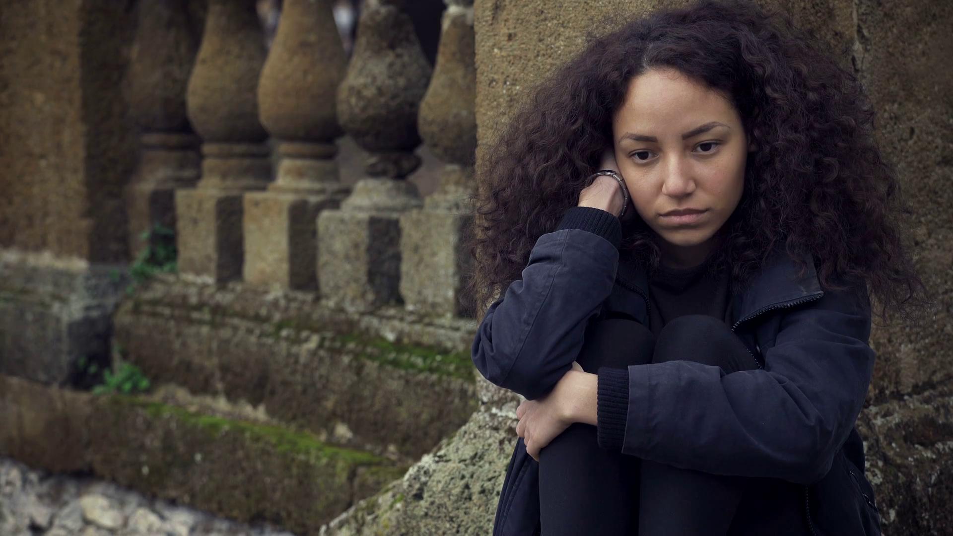 sad depressed woman sitting a