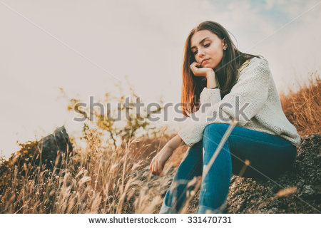 Sad young girl sitting alone on a stone outdoors. Teenage girl thinking  thoughtfully. Hope - Girl Thinking PNG HD