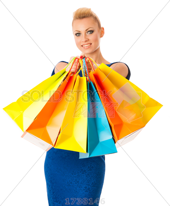 Stock Photo of Happy blonde woman holding bunch of vibrant shopping bags  after she bought a lot of things on sale - Girl With Shopping Bags PNG