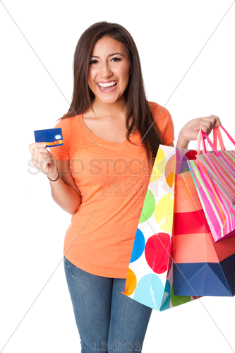 Stock Photo of Happy woman holding shopping bags and credit card on white  background - Girl With Shopping Bags PNG