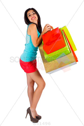 Stock Photo of Lovely lady smiling cutely holding colorful shopping bags  over white background - Girl With Shopping Bags PNG