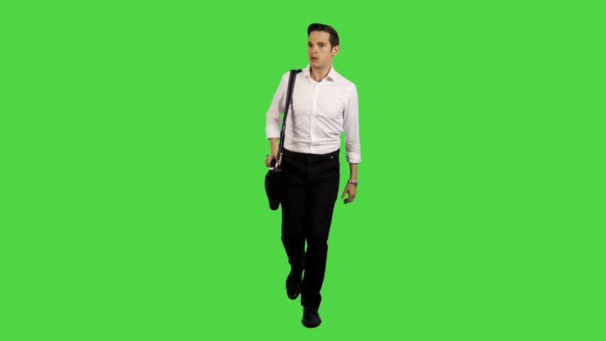 young business man walking upset towards camera in a long frontal shot,  carrying a laptop - Handsome Man PNG HD