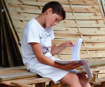 File:A boy reading his homework.png - His PNG