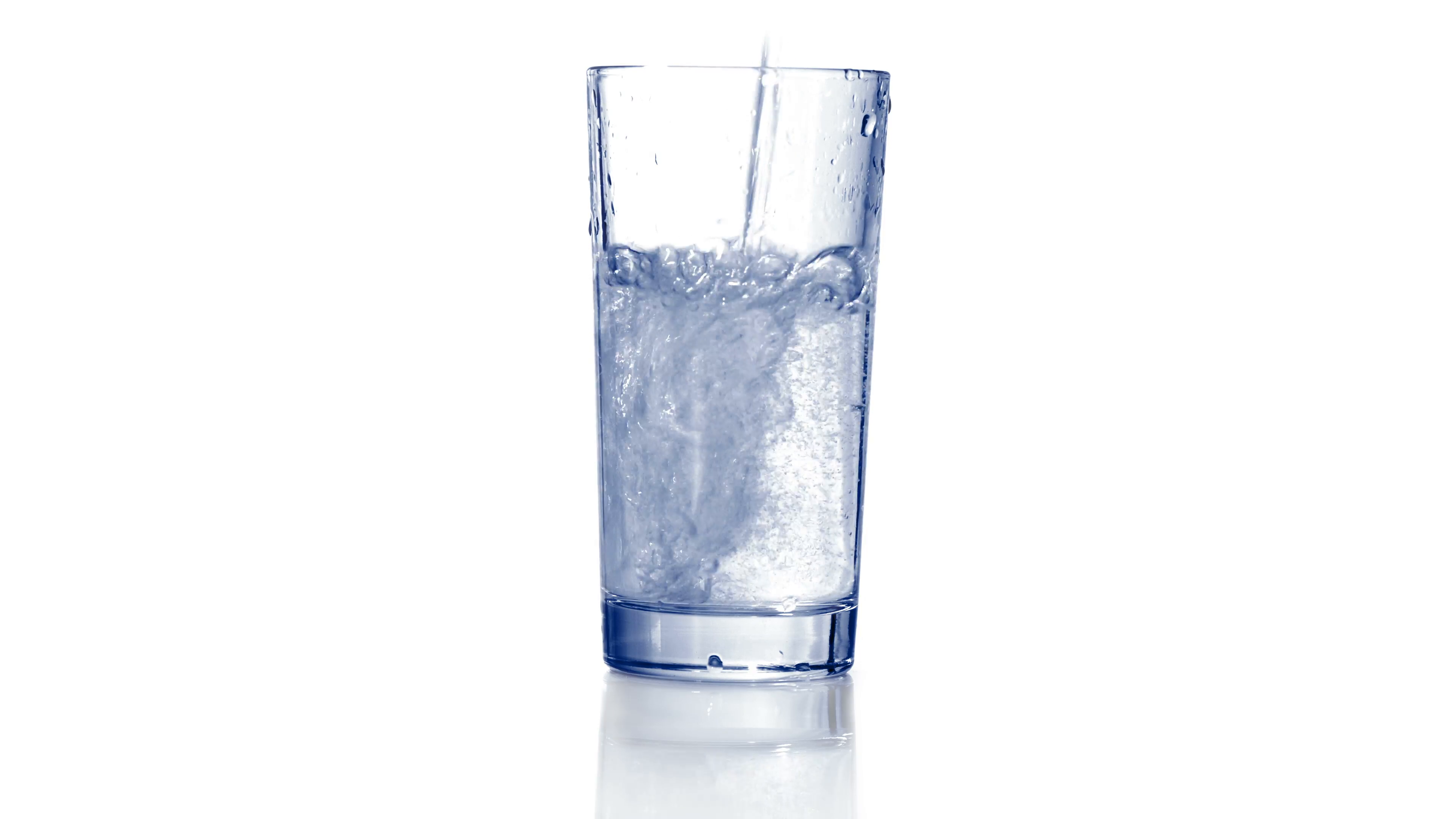 Filling empty glass with carbonated water, dropping ice cubes. Bubbles come  out. Close up, extreme close up. 4K Ultra HD. Stock Video Footage -  VideoBlocks - Ice In Glass PNG