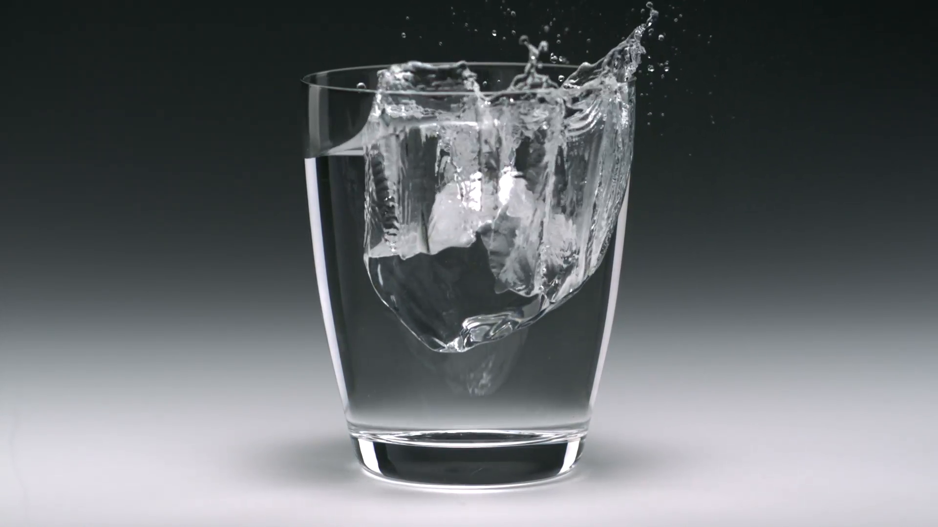 Ice cube in glass of water, Slow Motion Stock Video Footage - VideoBlocks - Ice In Glass PNG