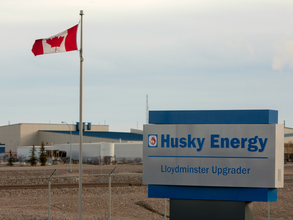 A Canadian flag blows in the wind on the property of the Husky Energy  Lloydminster Upgrader. - Logo Husky Energy PNG
