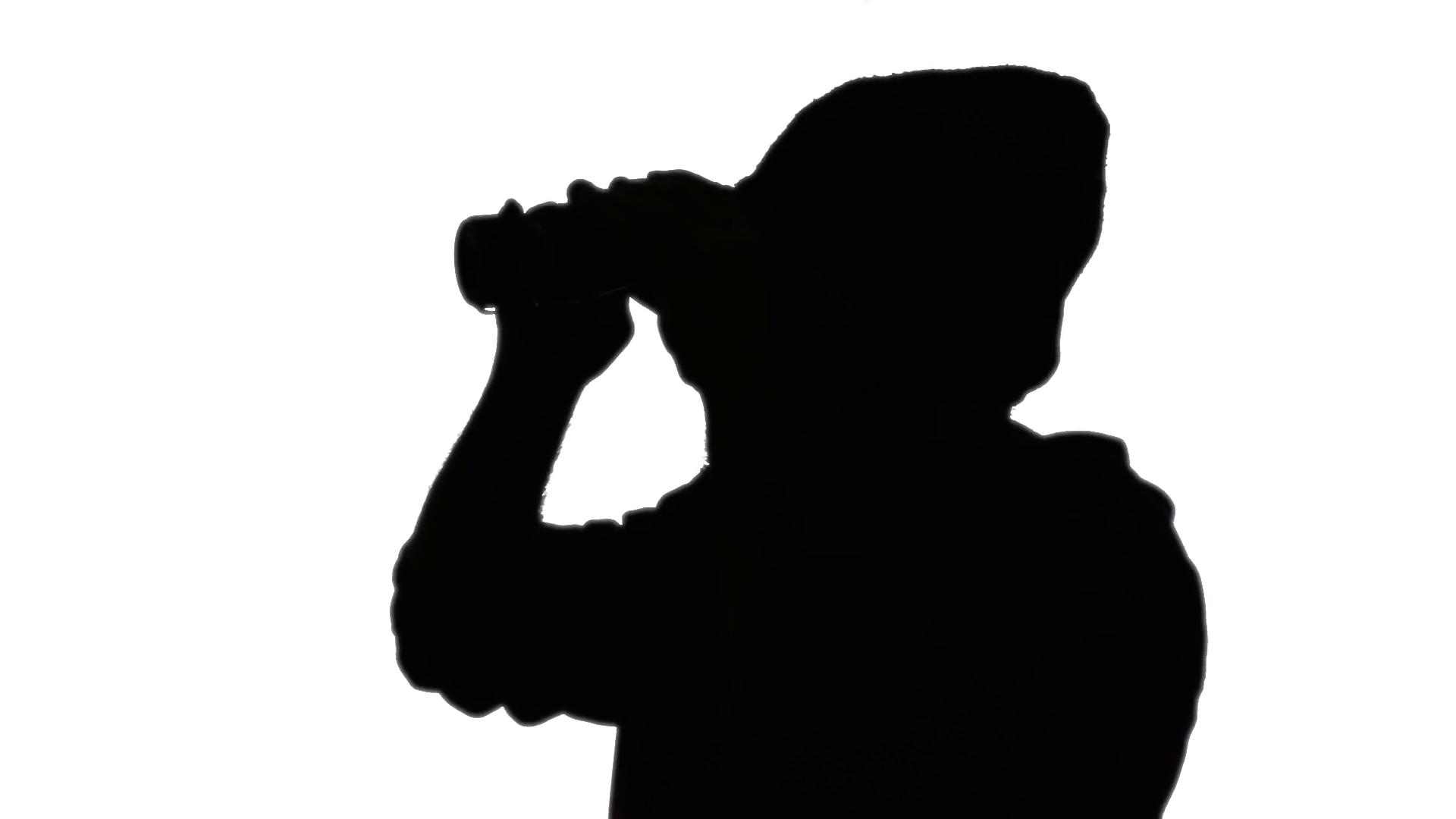 Silhouette man binoculars. A man looking around through a pair of binoculars.  Silhouette shot. Stock Video Footage - VideoBlocks - Looking Through Binoculars PNG