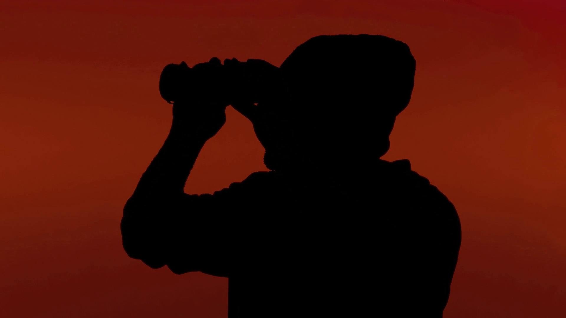 Silhouette man binoculars red. A man looking around through a pair of  binoculars. Silhouette shot on red background. Stock Video Footage -  VideoBlocks - Looking Through Binoculars PNG
