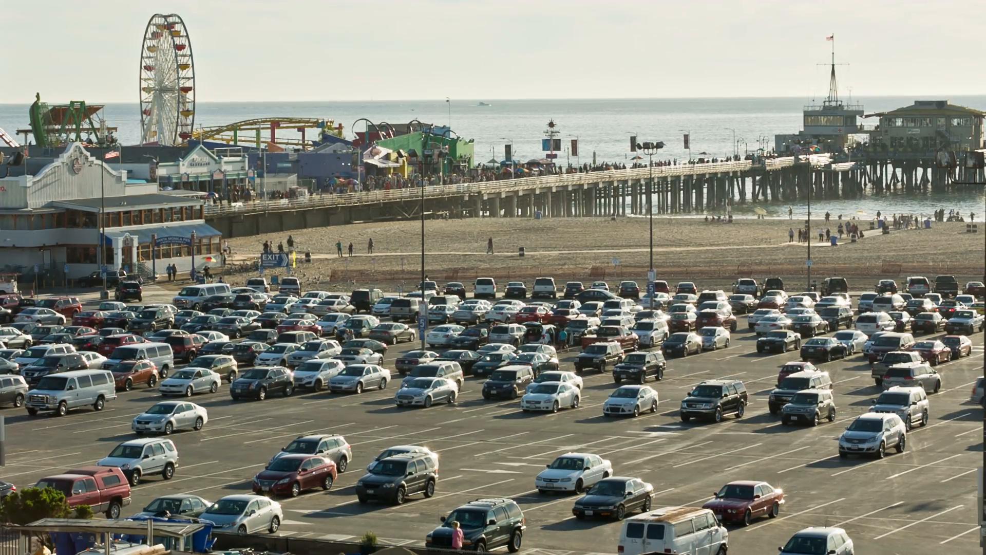 busy parking lot outside Santa Monica Pier, cars parking with ferris wheel  in background 1080 HD Stock Video Footage - VideoBlocks - Parking Lot PNG HD
