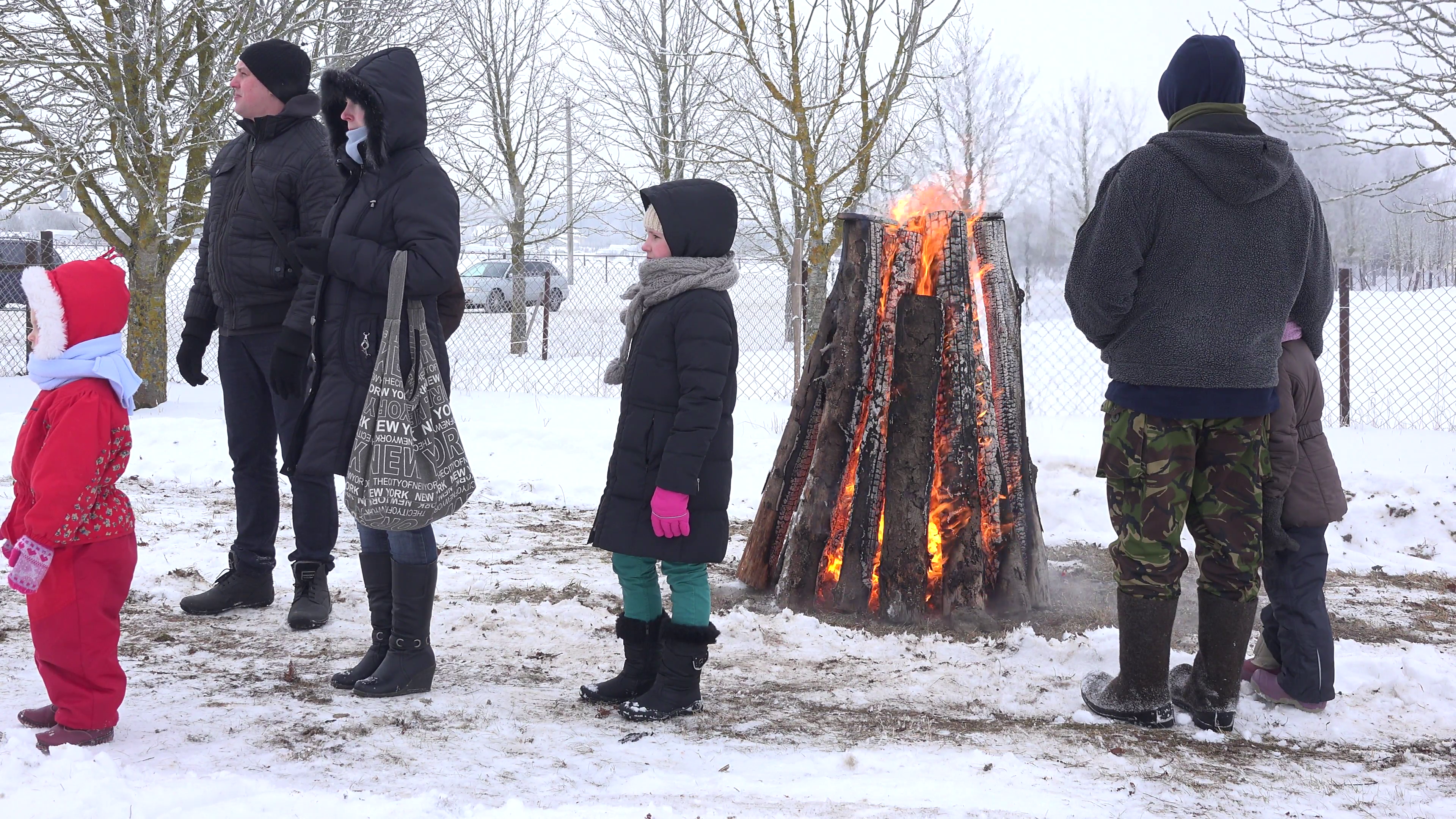 People warm near huge fire place in cold winter day. 4K Stock Video Footage  - VideoBlocks - People In Cold Winter PNG