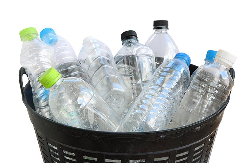 Plastic bottles in a basket - Plastic Bottles PNG