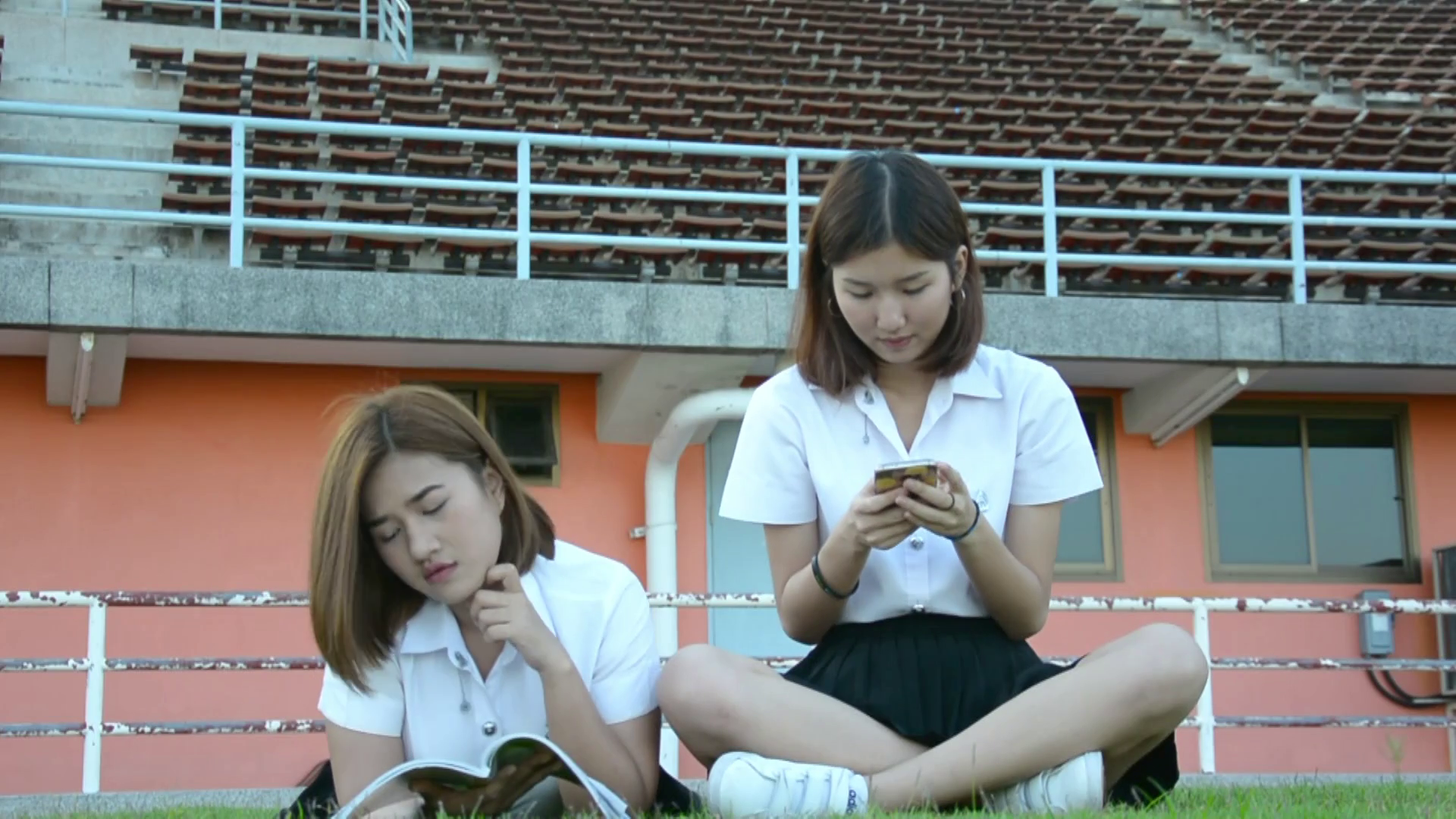 Cute Asian Thai college student girl in university uniform reading text  book and ask her friend that playing with mobile to explain what she donu0027t  PlusPng.com  - PNG HD Student Reading
