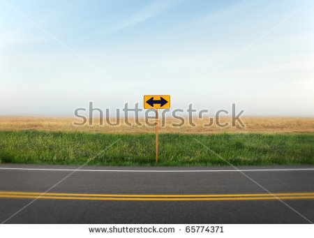 A road sign with arrows pointing in two directions along a quiet country  road. - PNG Horizontal Road