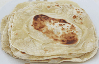 A batch of freshly made vegan rotis - PNG Roti