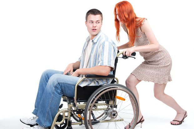 Young woman pushing a young man in a wheelchair - Pushing Wheelchair PNG