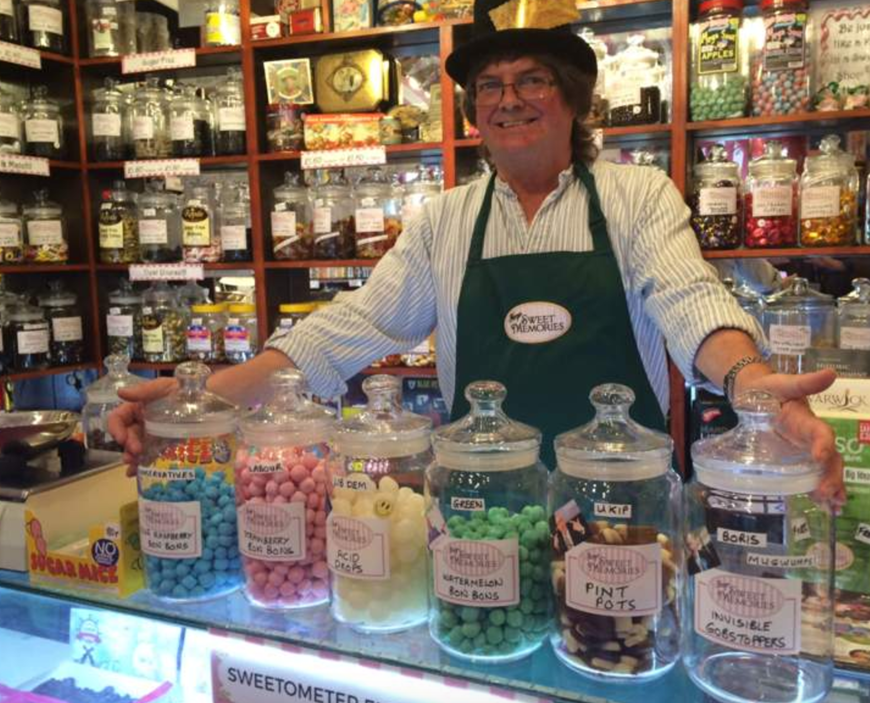 Nigel Ackroyd, of Maryu0027s Sweet Memories on Market Place, puts the name of a  different political party on each jar and follows the sales to see who is  likely PlusPng.com  - Shop Owner PNG