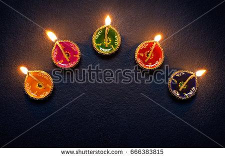 Colorful clay diya lamps lit during diwali celebration - Simple Diya PNG