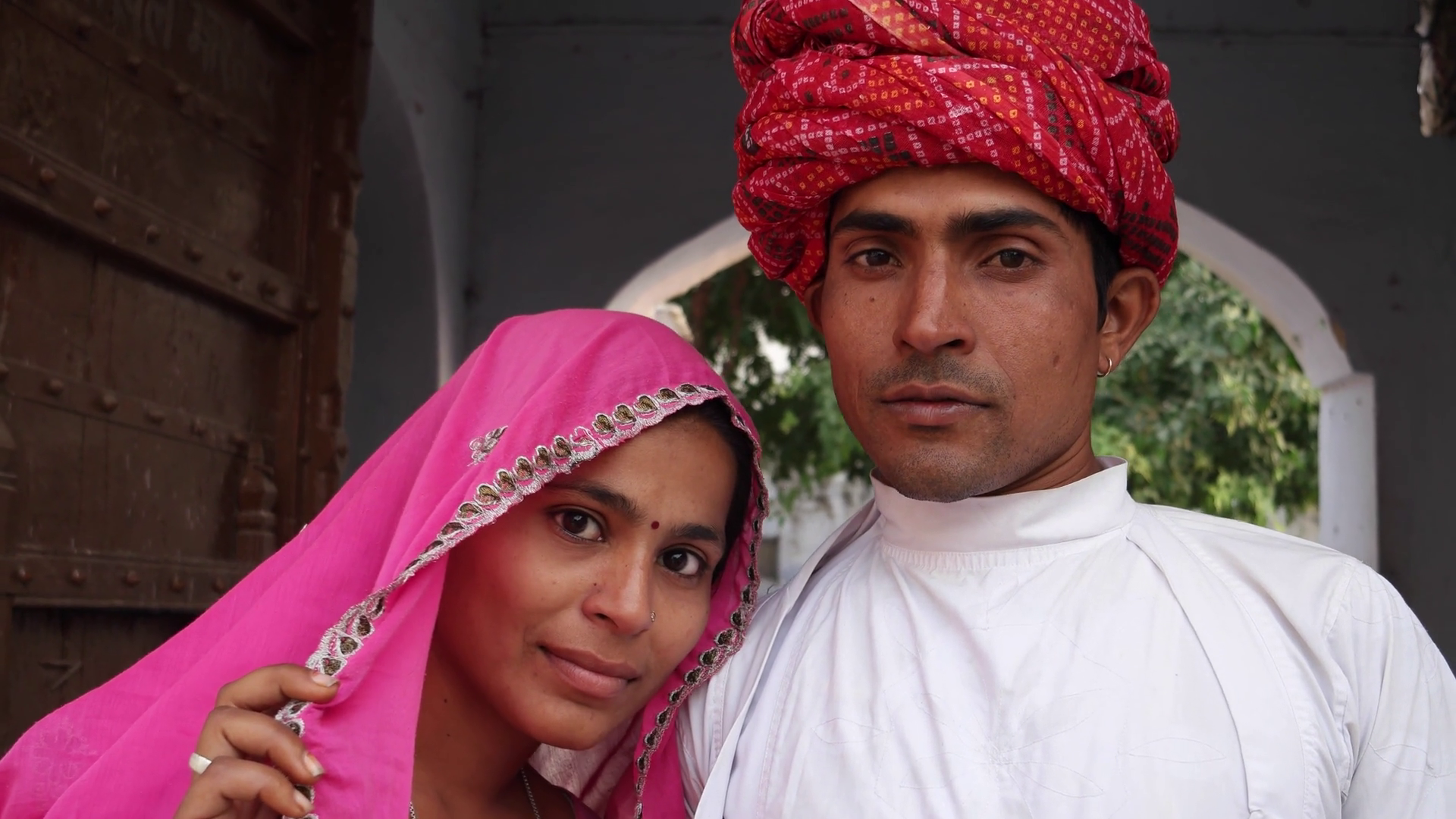 Attractive Indian couple in traditional dress against old heritage  architectural backdrop in Rajasthan, India Stock Video Footage - VideoBlocks - Traditional Dress Of Rajasthan PNG