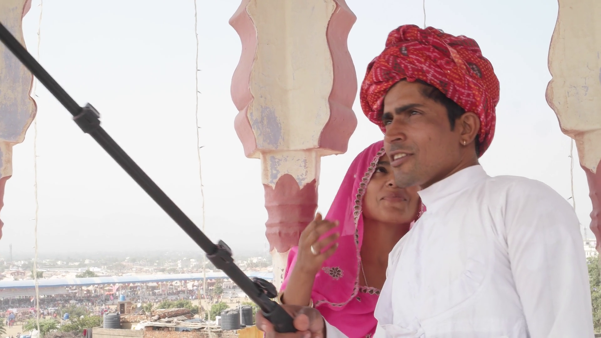 Attractive Indian couple in traditional dress getting ready and take  selfies on their mobile phone camera in Rajasthan, India Stock Video  Footage - PlusPng.com  - Traditional Dress Of Rajasthan PNG