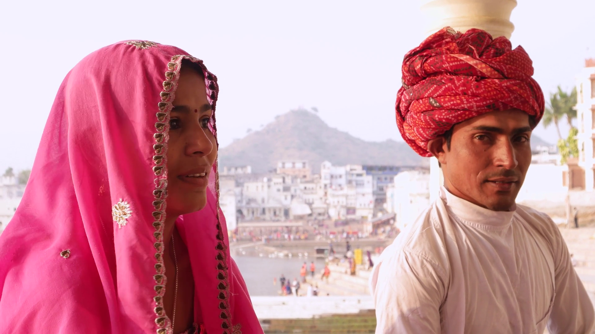 Indian couple in traditional dress sitting with Pushkar lake in the  background, Rajasthan, India Stock Video Footage - VideoBlocks - Traditional Dress Of Rajasthan PNG