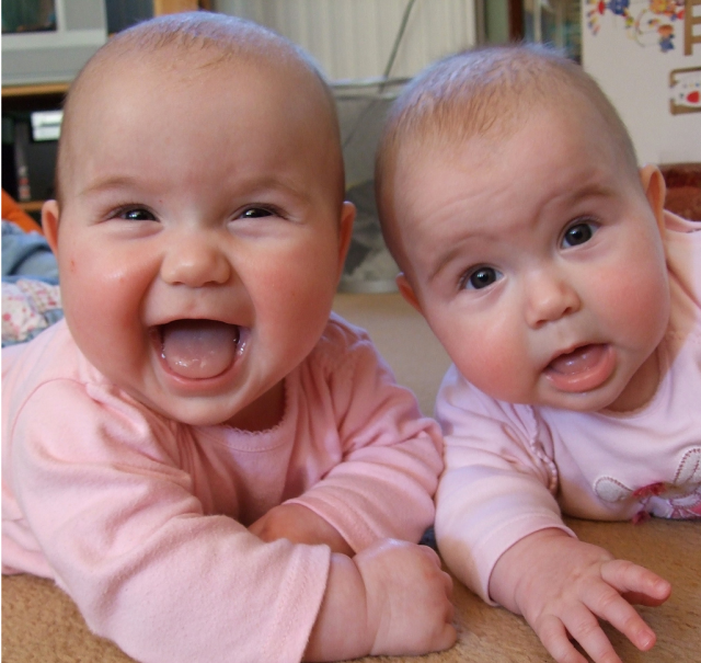 Very cute twin baby girls smiling and looking at the camera.PNG - Twin Baby PNG HD