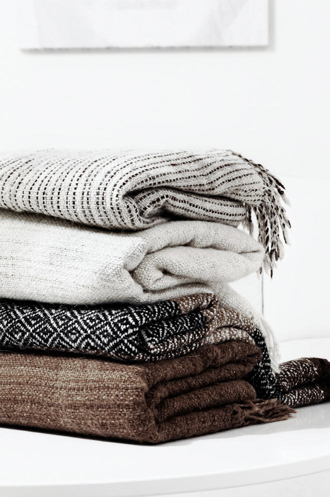 A neutral throw doubles as a blanket and a subtle pop of décor in a room  with a clean palette. - Warm Blanket PNG